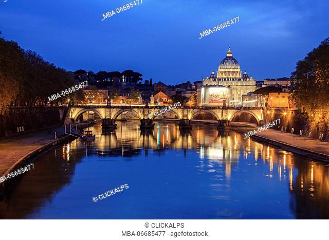 Dusk on Tiber River with bridge Umberto I and the Basilica di San Pietro in Vaticano in the background Rome Lazio Italy Europe