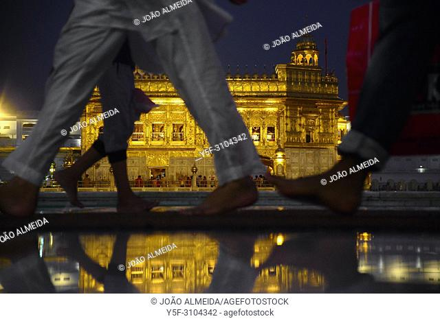 Pilgrims walking barefoot at Golden Temple, as no shoes are allowed