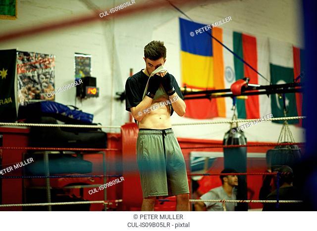 Boxer exercising in boxing ring