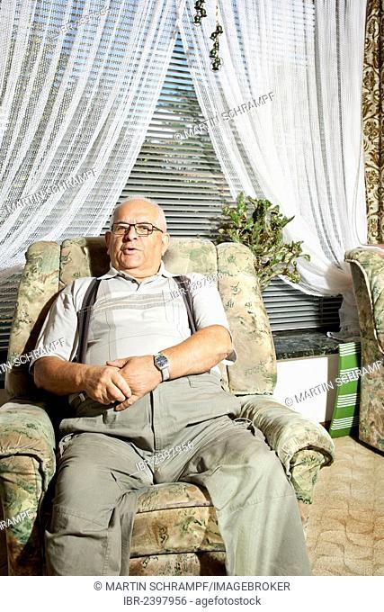 Elderly man sitting in a recliner