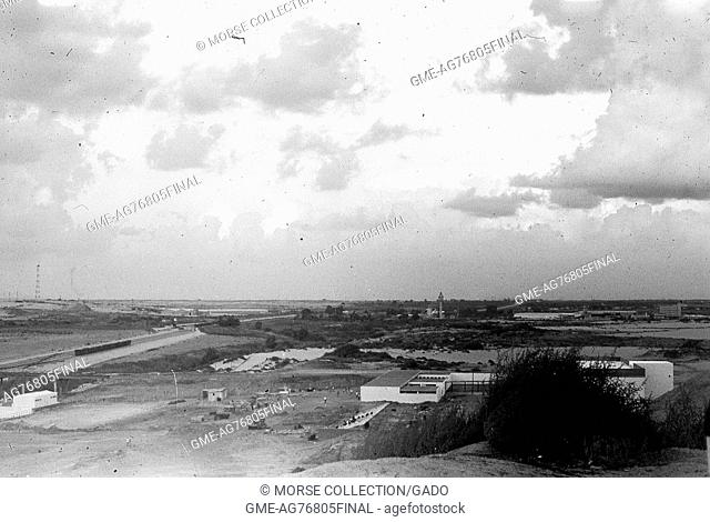 Panoramic view facing south of buildings and roadways in El Arish, Gaza, Israel, November, 1967