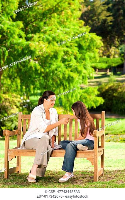 Cute girl with her mother in the park