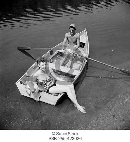 Elevated view of man and woman in fishing boat