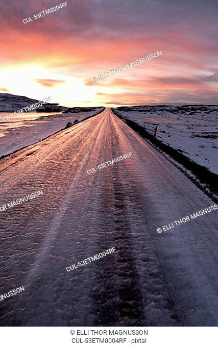 Frozen road in snowy landscape