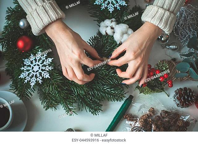 Christmas Background with Female Hands and Christmas Decorations