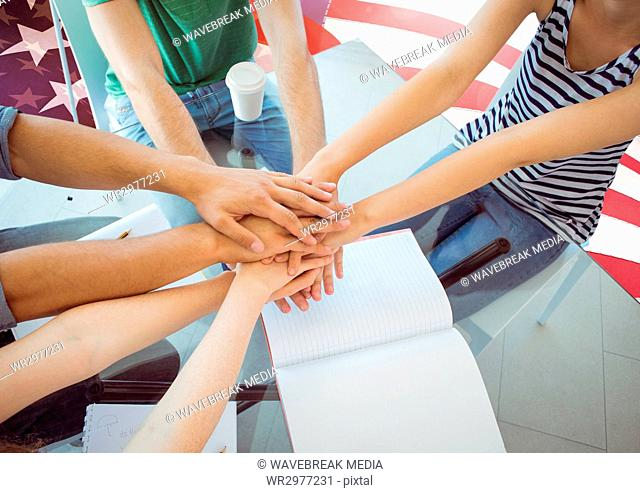 Friends with hands together against american flag