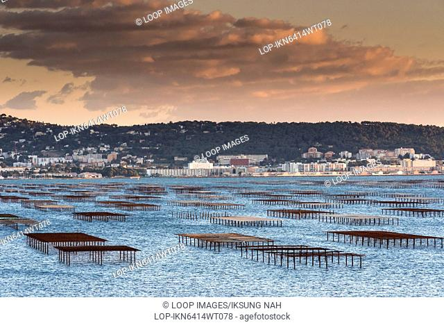 View over oyster beds in Etang de Thau with Sete in the background in Languedoc Roussillon
