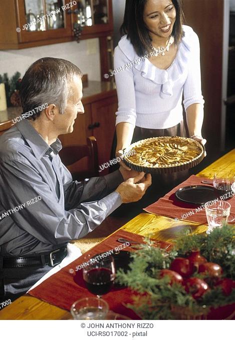 Woman serving tart