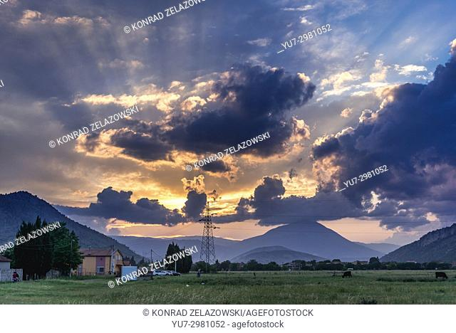 Sunset above mountains seen from outskirts of Podgorica, capital city of Montenegro