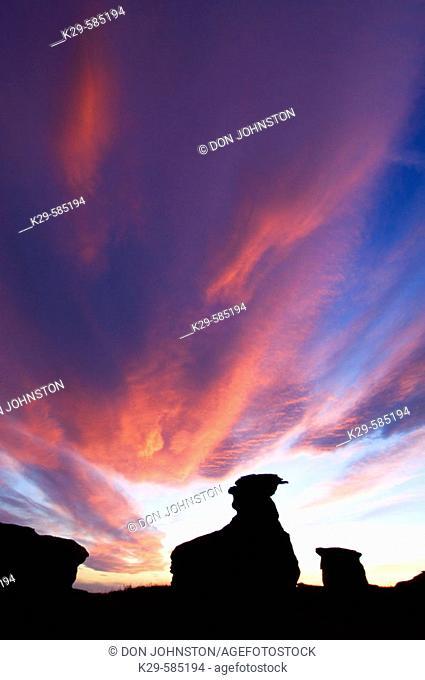 Sunset skies over sandstone hoodoos in Milk River Valley. Writing On Stone Provincial Park. Alberta