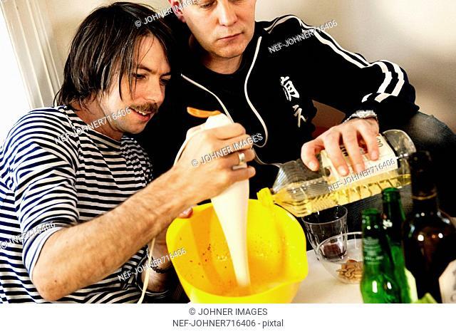 Friends preparing dinner, Sweden