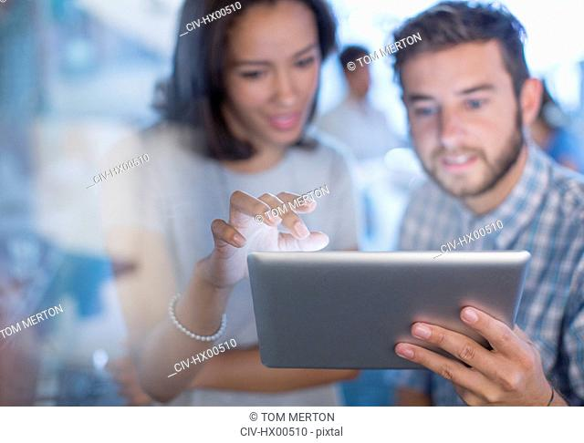 Creative business people using digital tablet in office