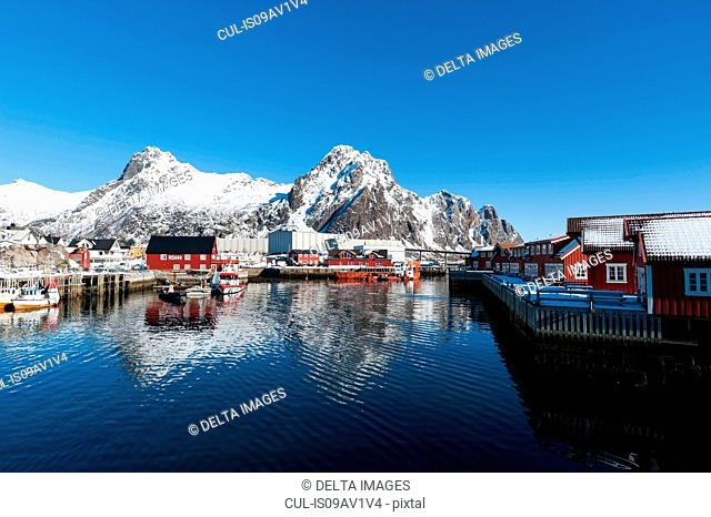 Waterfront houses and snow capped mountains, Svolvaer, Lofoten Islands, Norway