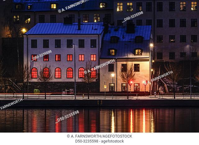 Stockholm, Sweden A red house on the shoreline of Sodermalm