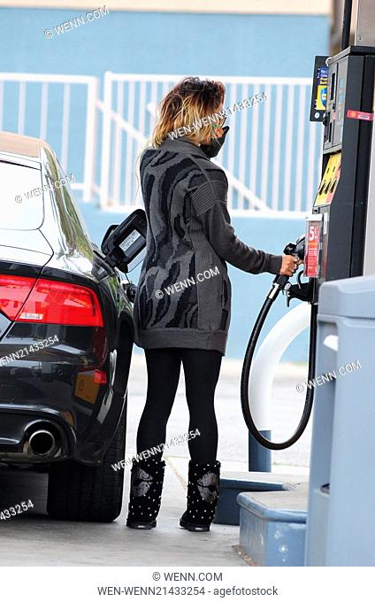 Vanessa Hudgens leaves her yoga class and fills up her car with gas covering her face with her hand Featuring: Vanessa Hudgens Where: United States When: 07 Jun...