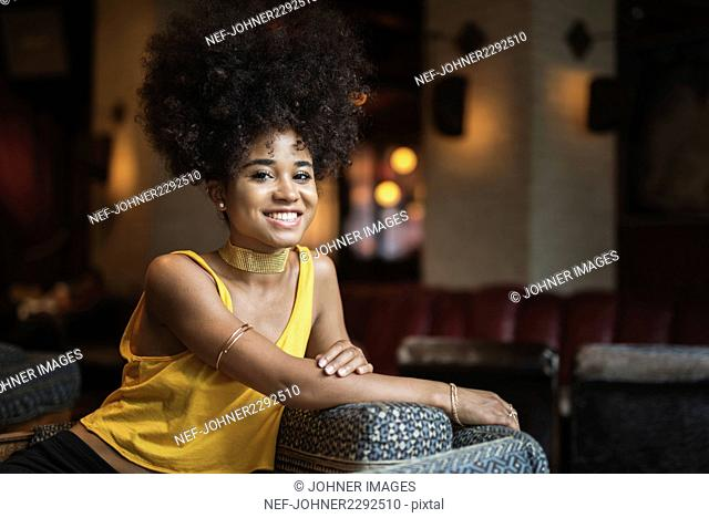 Portrait of young woman with big hair