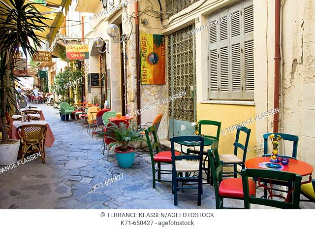 Colorful outdoor restaurants in the narrow alleys and streets of Hania on the Greek island of Crete