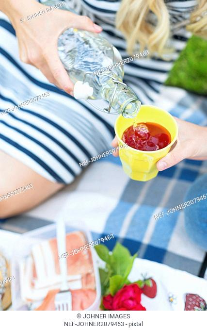 Woman pouring water into cup