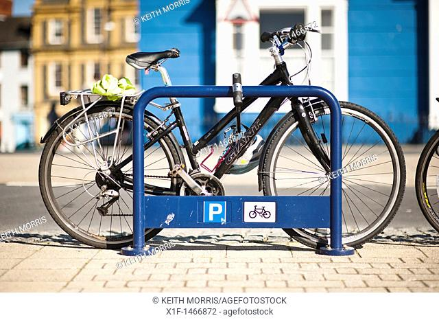 Bicycles securely attached to a cycle stand, UK