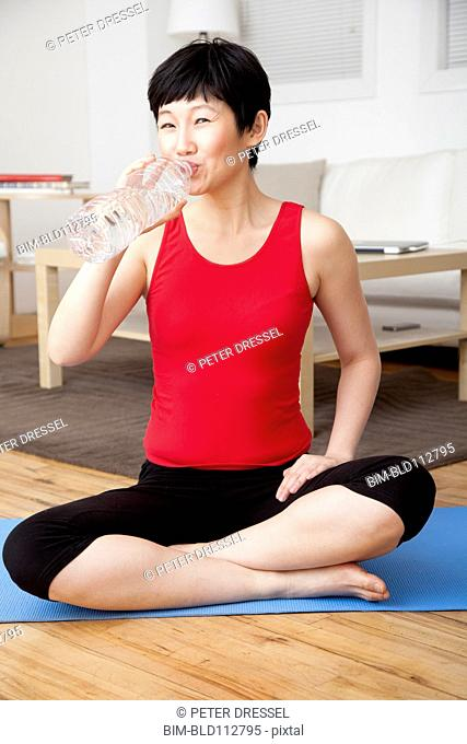 Woman drinking water in living room