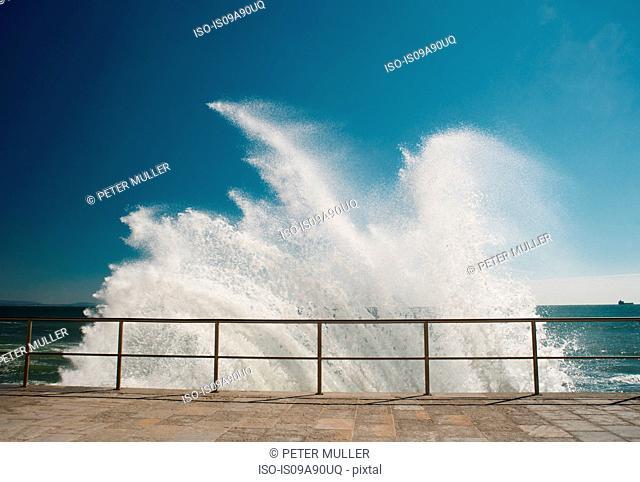 Waves crashing against pier