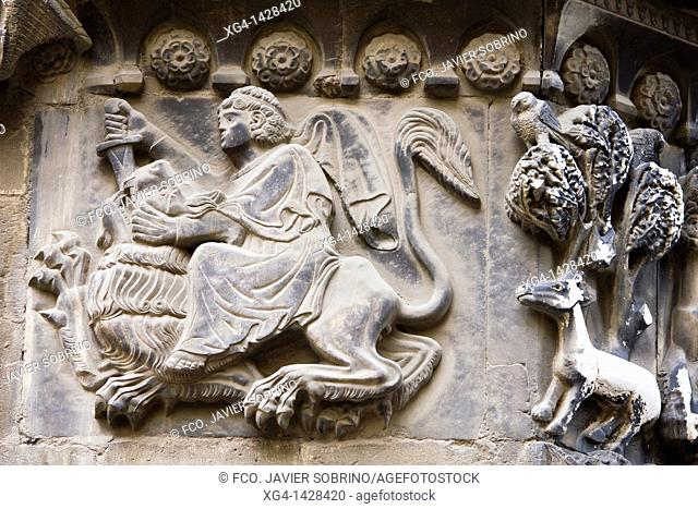 Fight with a lion in a relief of San Ivo Portal Gothic Cathedral in Barcelona - Catalonia - Catalonia - Spain