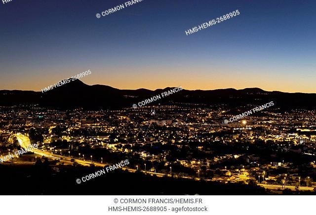 France, Auvergne, Puy de Dome, Clermont Ferrand, Chaine des Puys in the background, dusk