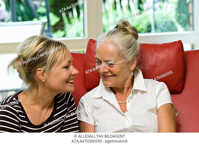 Eldery lady listening to her daughter