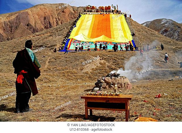 The Buddhist monks of the yellow hat sect of the Tongren monastery in Sichuan province in China are enrolling their huge Thankha at their annual festival