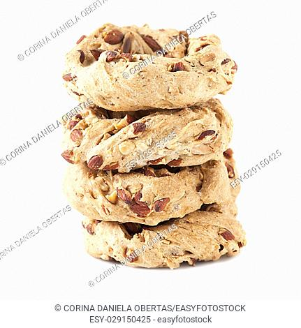 Stack of neapolitan cookies called taralli, isolated on white background. Taralli are typical bagels made in Naples with lard, almonds, flour and black pepper