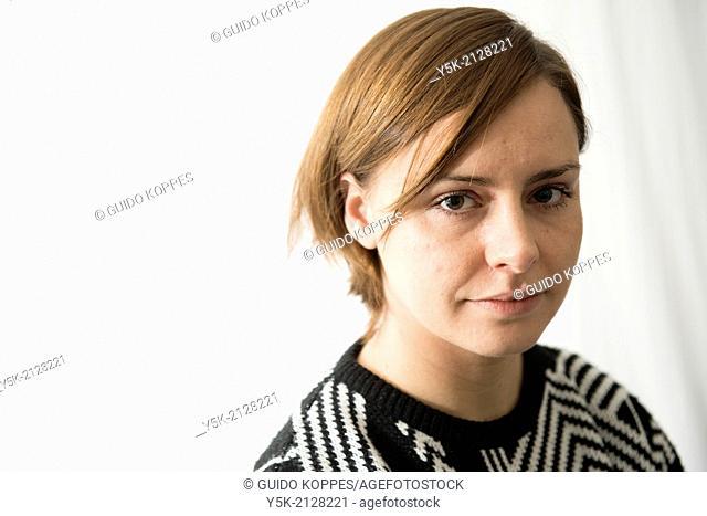 Studio Tuinstraat, Tuinstraat, Tilburg, Netherlands. Studio portrait of an young, attractive, serious looking brunette woman