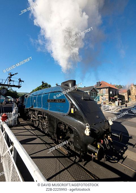 The vintage A4 Class steam locomotive Sir Nigel Gresley at Grosmont station on the North Yorkshire Moors Railway, near Whitby, North Yorkshire, UK