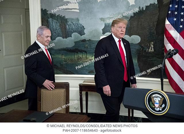 Prime Minister of Israel Benjamin Netanyahu (L) and US President Donald J. Trump (R) enter the Diplomatic Reception Room of the White House to deliver remarks...