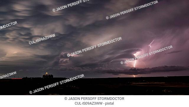 Lightning illuminates the remnants of two supercells