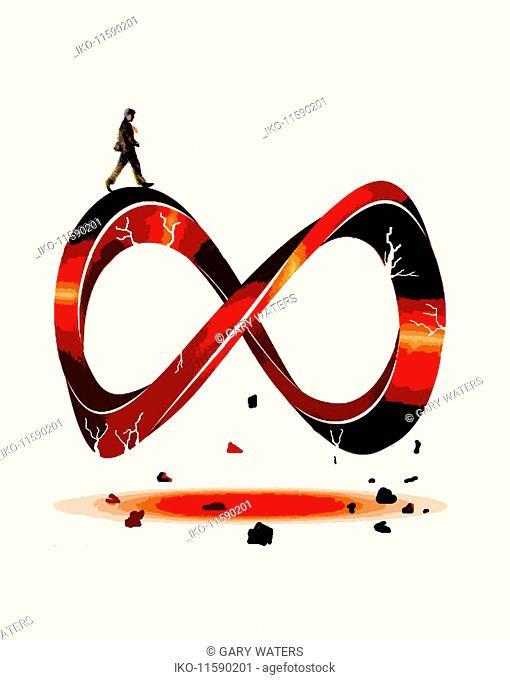 Man walking on crumbling infinity symbol