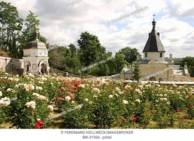 Ukraine Kiev the monastery of cave Kyjevo Pecers'ka Lavra on the way from nearby to the far caves church of spring and the Antonij spring blossom roses trees...