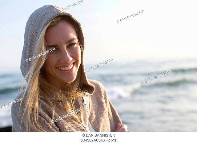 Woman in hoodie on beach