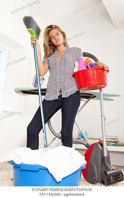 Teenage girl bored with housework