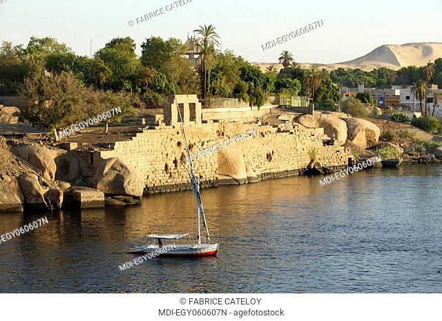 Felouque on the Nile close to the granite rocks and the ruins of the Elephantine Island