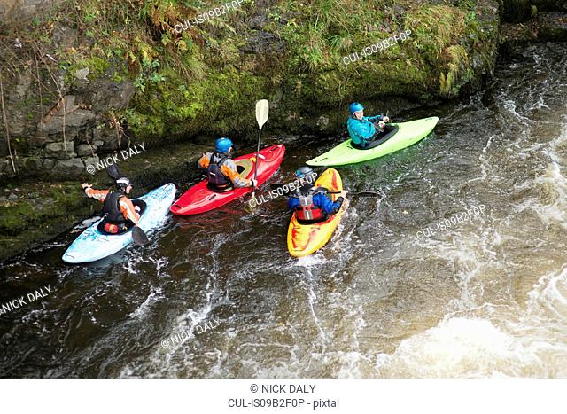 High angle view of kayakers on River Dee rapids, Llangollen, North Wales
