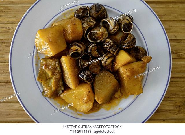 Greek Cuisine. Cooked Snails with Roast Potatoes, Cretan Style