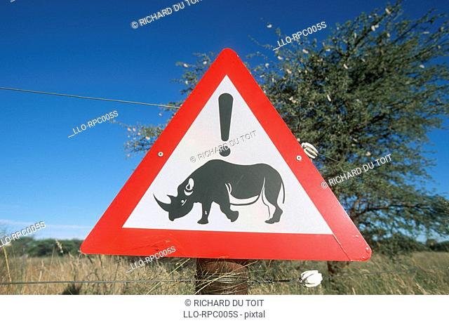 Beware of rhino signpost. Vaalbos National Park, Northern Cape Province, South Africa