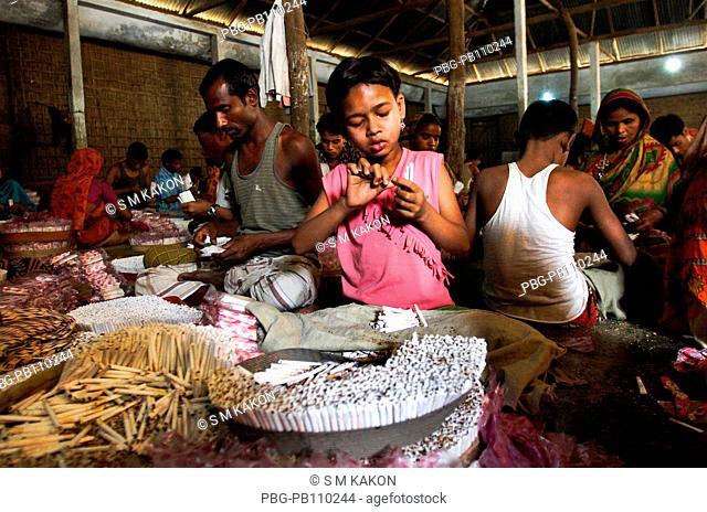 Children work at bidi, shredded tobacco factory at Haragach Rangpur, Bangladesh March 2010