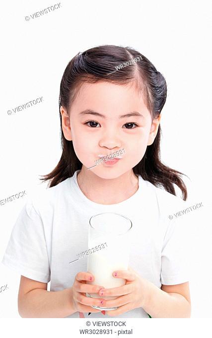 The little girl drank the milk