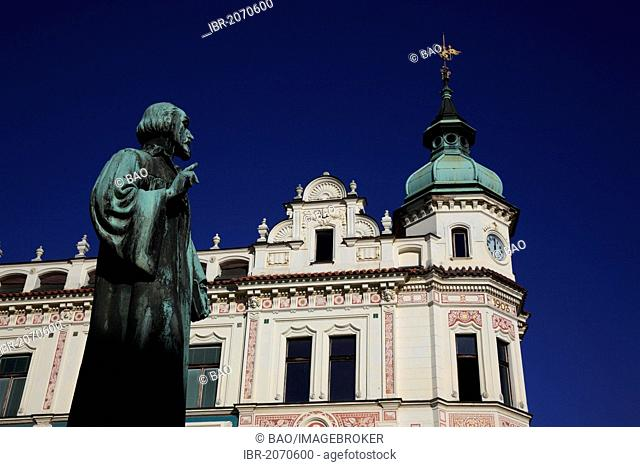 Jan Hus monument in front of a historic building of the Prague archbishops, Roudnice nad Labem, North Bohemia, Bohemia, Czech Republic, Europe