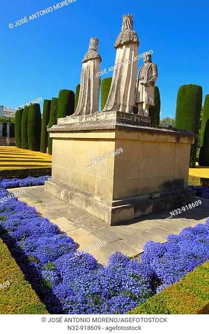Statues of the Catholic Monarchs (Queen Isabella I of Castile and King Ferdinand II of Aragon) and Christopher Columbus in the Alcazar of the Christian Kings...