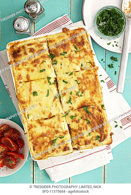 Lasagne with parsley and tomato salad