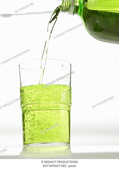 Bottled Drink being poured into glass