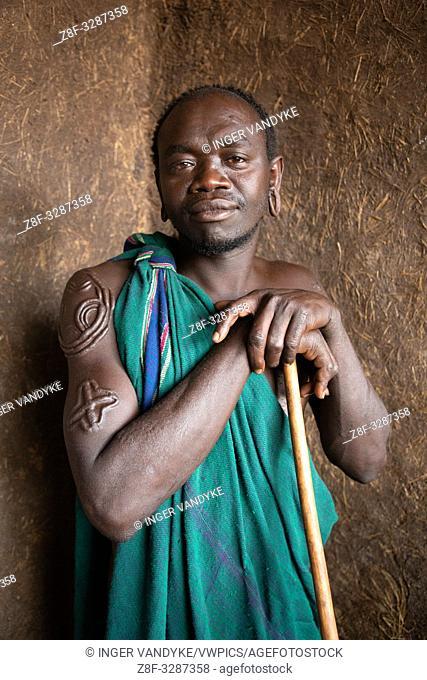 Portrait of Barshamu, a traditional Suri man near Turgit in southern Ethiopia