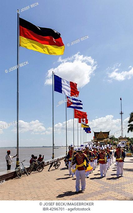 Chapel, music ensemble, boulevard with flags along river Tonlé Sap, Phnom Penh, Cambodia